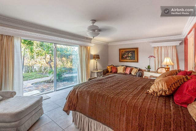 The Master Bedroom with access to the pool.