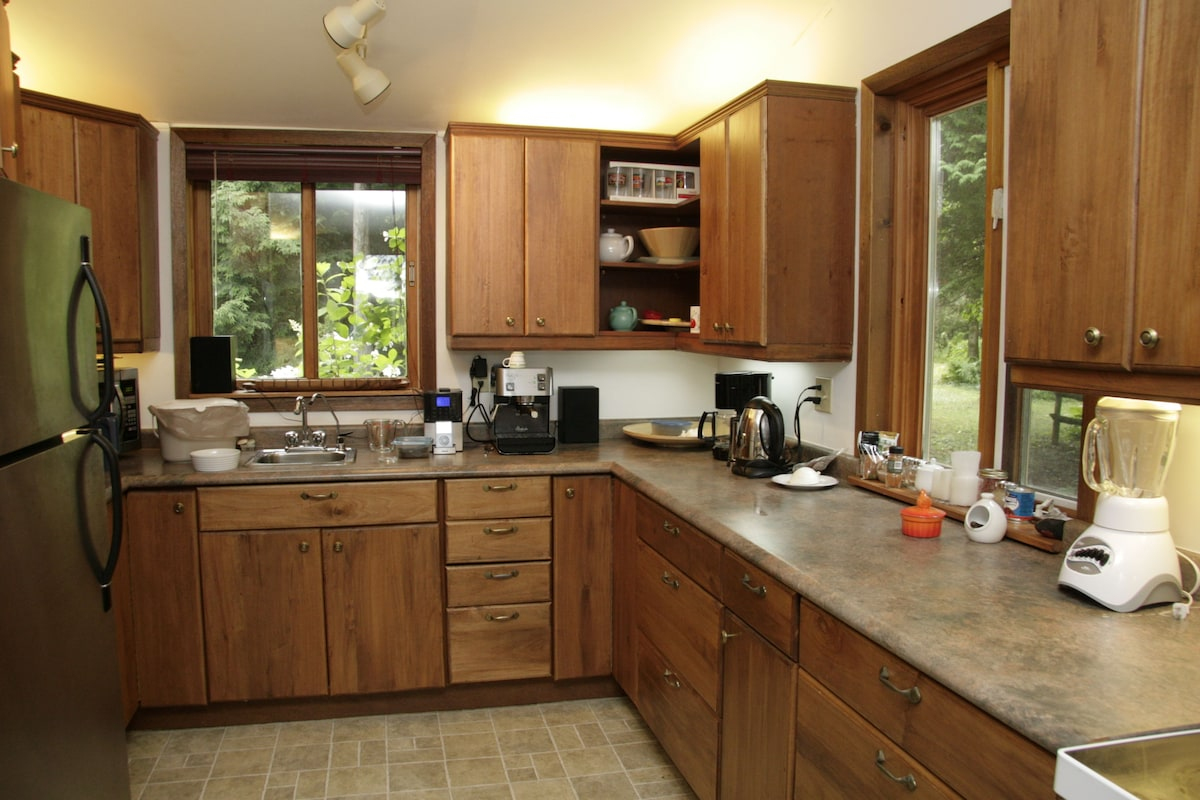 Gourmet kitchen with stainless steel fridge, espresso machine, fully equipped for cooking up a storm if you so desire.