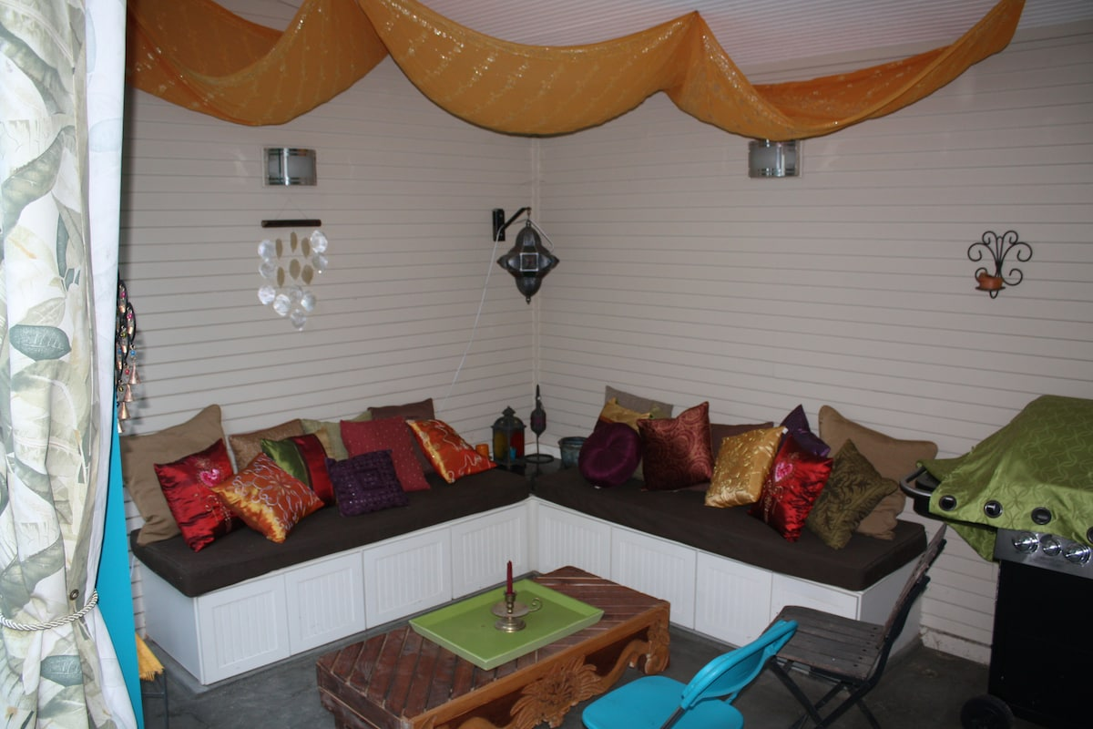 Outdoor entertaining area/lounge- perfect for relaxing in the evening! Curtains close for extra privacy or for weather