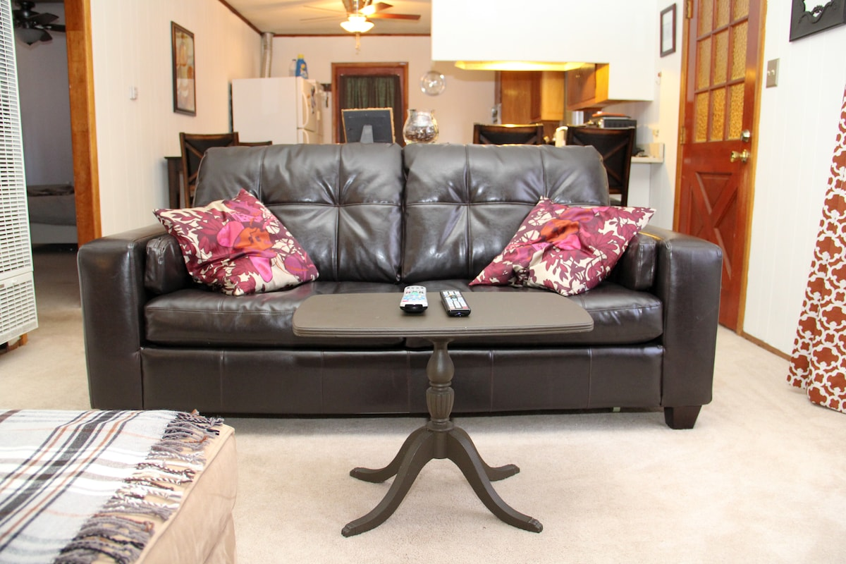 Comfy Jennifer Convertible couch bed. We have an extra down comforter, sheets, and pillows.