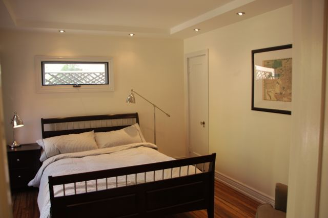 Bedroom with queen size bed and generous closet.