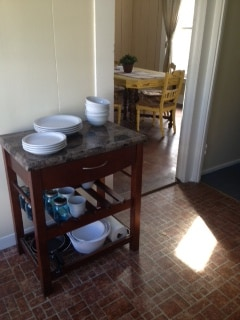 Butcher block in the little cottage kitchen, doorway to dining room