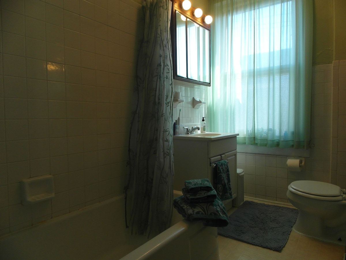 This shared bathroom is fresh, bright and clean.