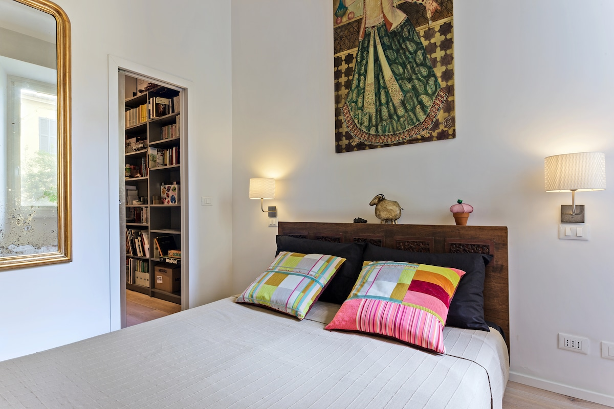 The master bedroom offers an antique queen bed
