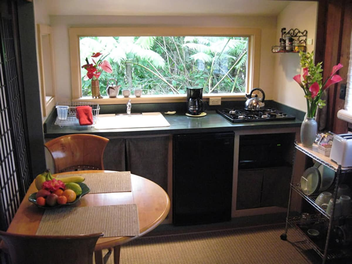 Enjoy fresh fruit, granola, banana bread and yogurt in your fully equipped kitchenette with a view of the rainforest.