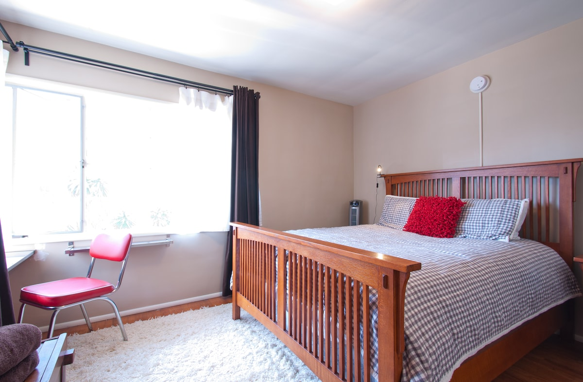Bright and airy master bedroom has queen-size bed, and television with Apple TV.  Light-blocking curtains.