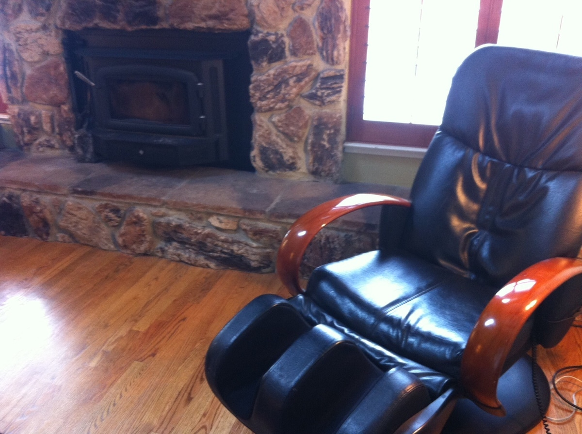 massage chair next to fireplace in living room