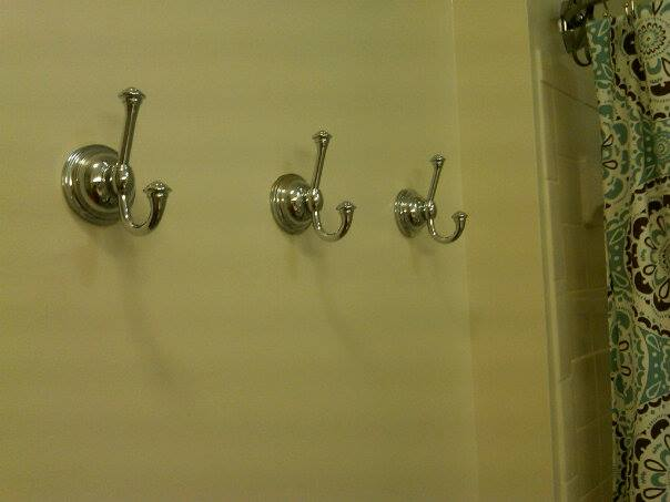 Some folks use towel bars. I chose towel hooks.
