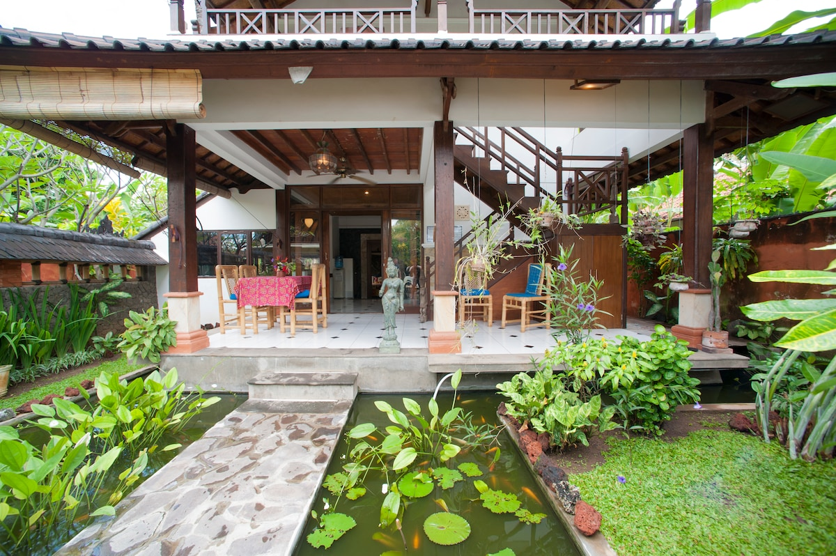 Front villa surrounded by fish ponds
