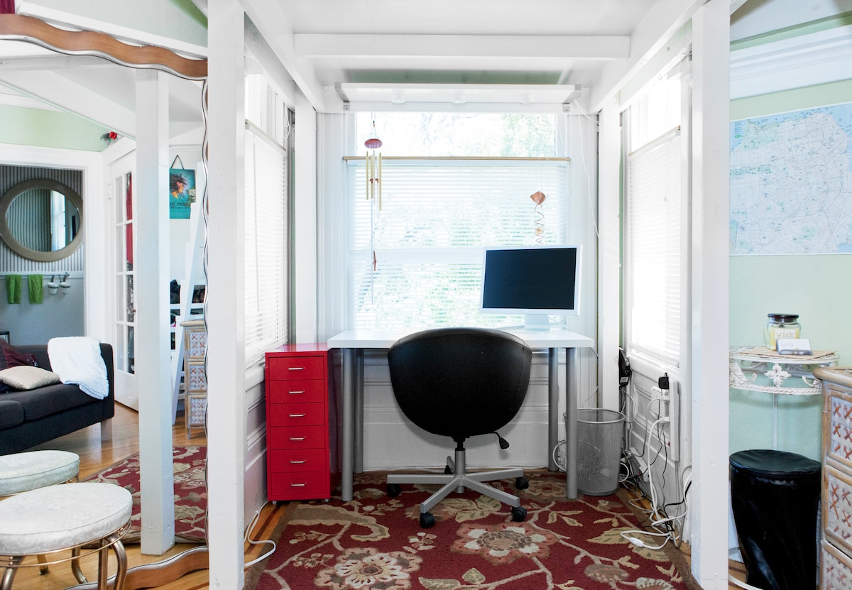 View from couch of office nook. Plenty of standing room underneath unless you're wicked tall.