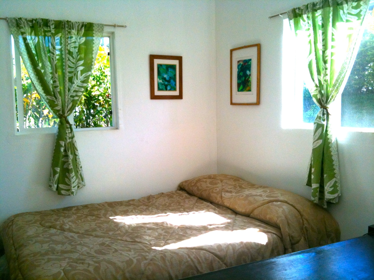 Your sunny bedroom, with a queen bed and cotton linen.
