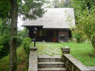 side view with wood shed