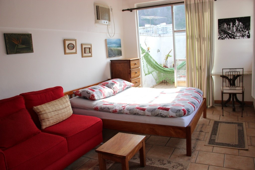 View of the bedroom, with hammock outside