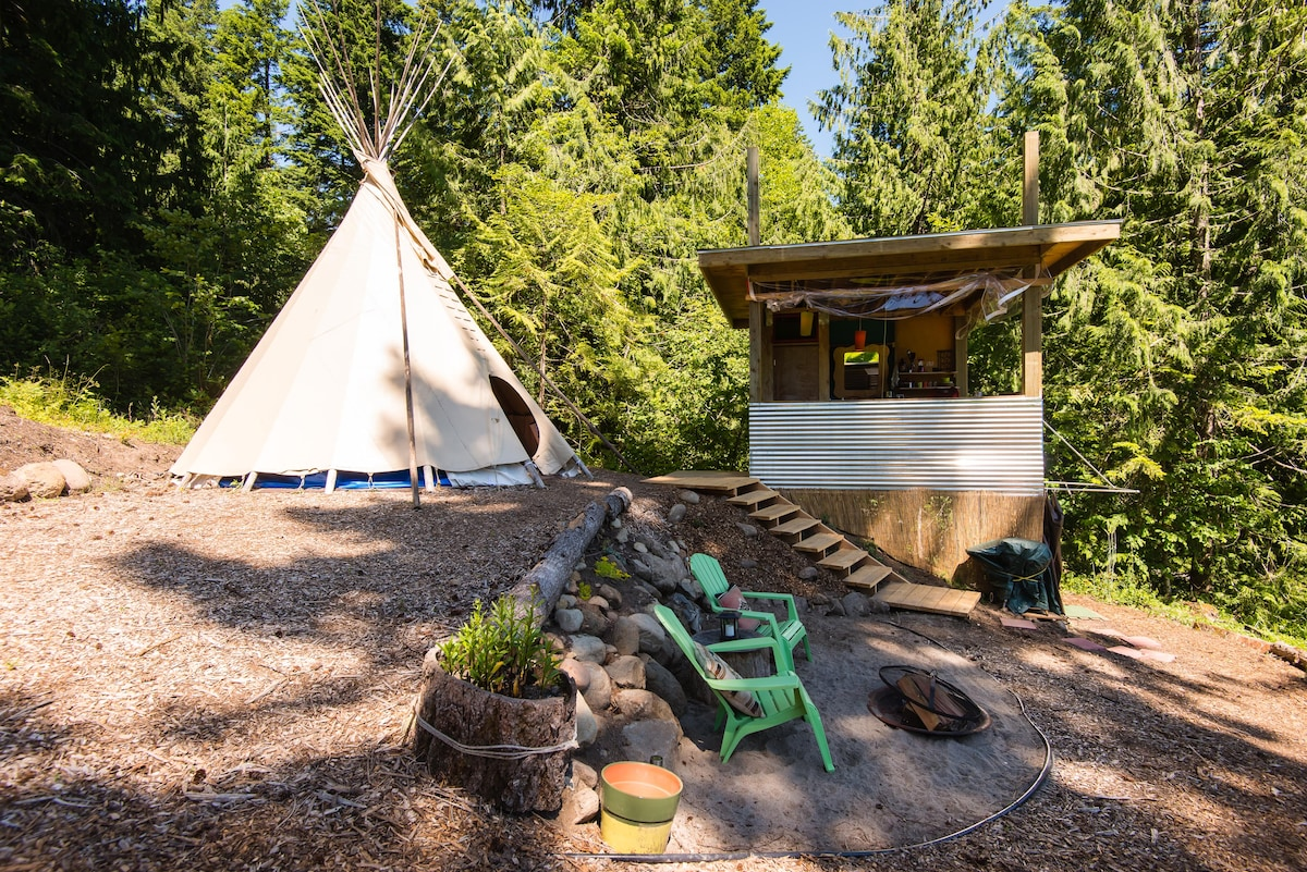 Here is your compound. You will have the tipi and the cool out building that has the flushing toilet and the open air kitchenette!