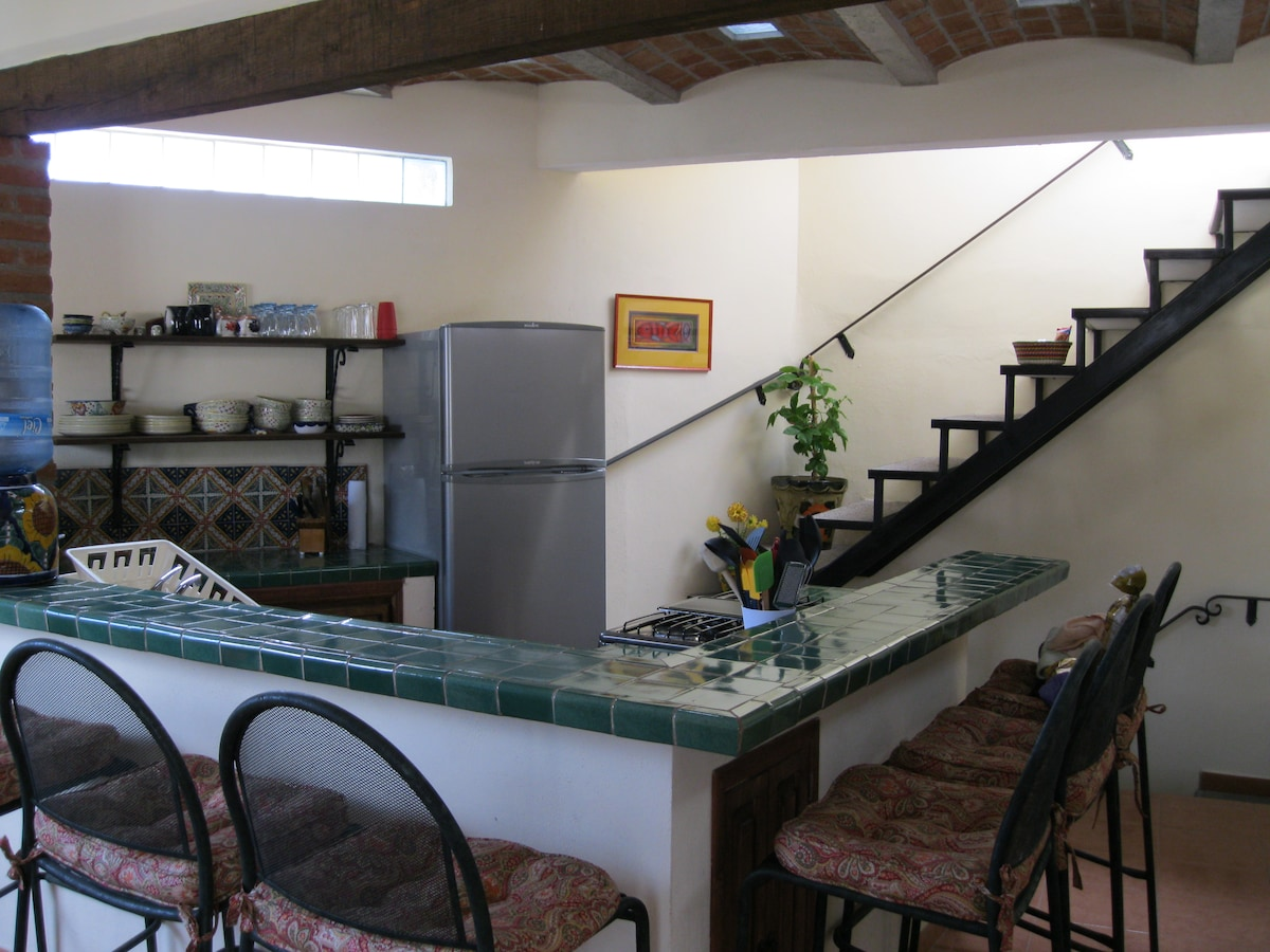 Kitchen with stairs to the roof
