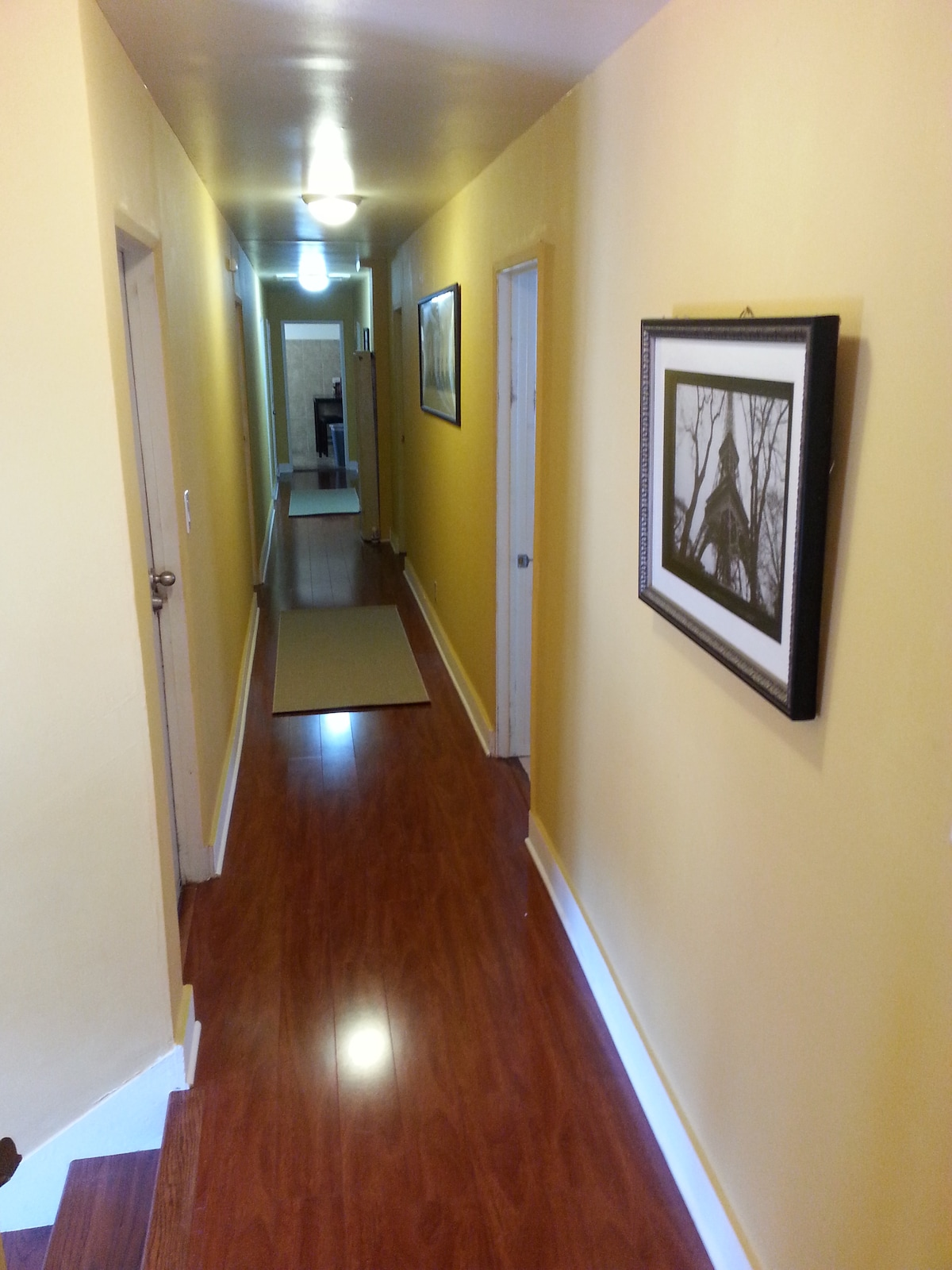 hallway leading to rooms and kitchen at end of hallway