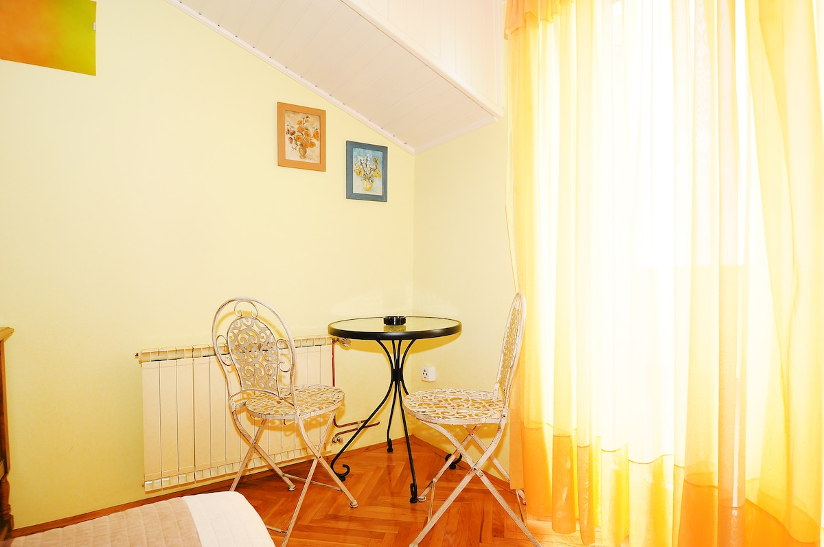 Bedroom 1. Table and chairs can be used on the balcony.