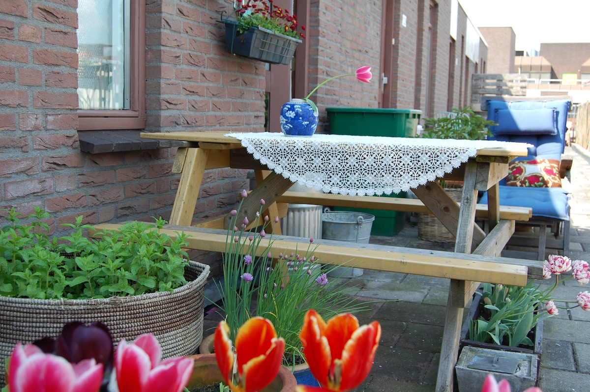 comfertable chair and table to sit outside in right season tulips and fresh mint will be growing.
