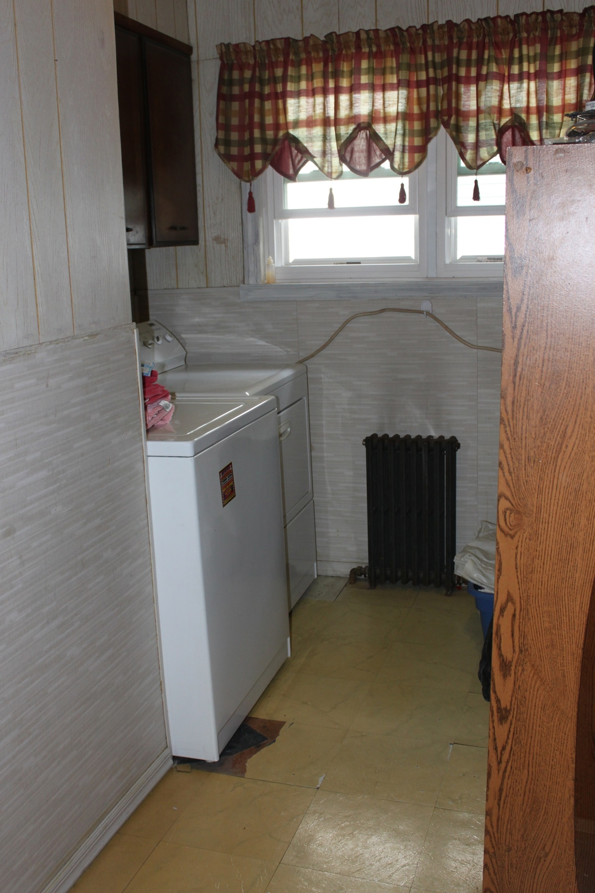 Laundry area is upstairs, off the living room