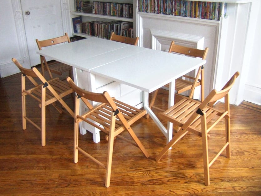 Living Room: A fold-away dining table and chairs for 6 make family dinners together easy, and can be put away in closet when not in use...