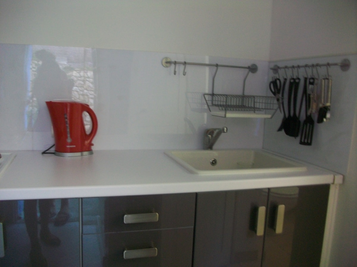 New fully equipped modern kitchen with small oven, two plate stove, fridge and microwavecand mio