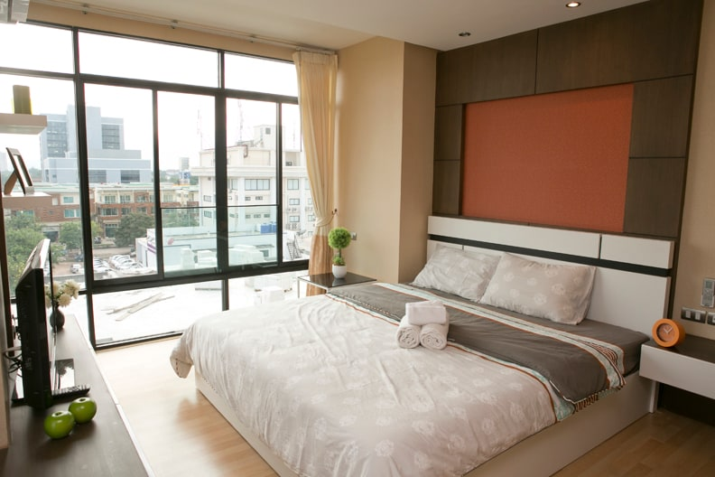 The bedroom has a king size bed with a great view. You can actually see the mountains from your bed.