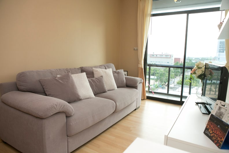 Relax in the living room with a very comfortable couch, TV and great view of the city.