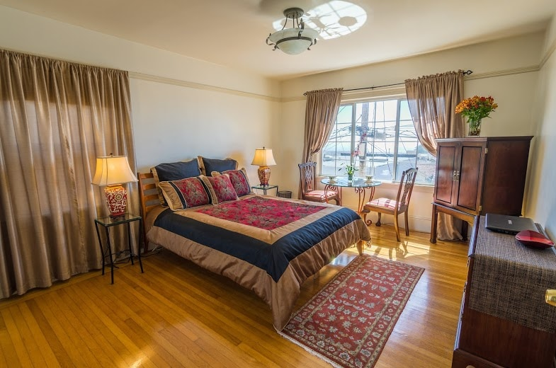The very comfortable queen bed has 4 fluffy down pillows and blanket, and luxury linens.