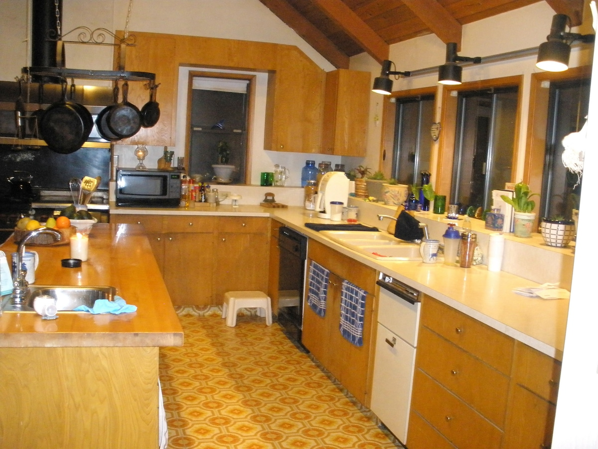 You can get lost in the 1970's kitchen (the butcher block island is 8' long)