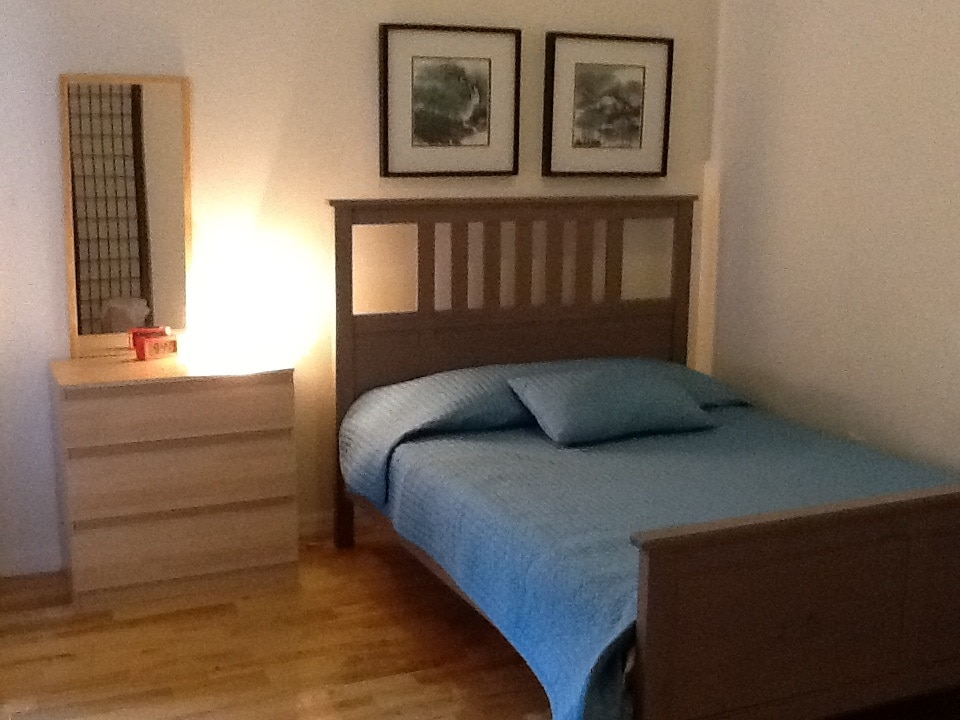 Bedroom has a full-sized bed and the room can also comfortably accomodate a twin or full-sized Aerobed.