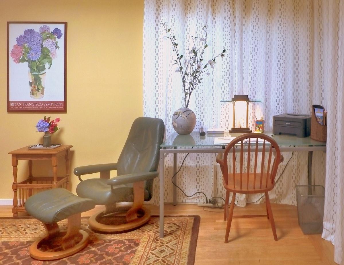 Work desk in living room, with laser printer