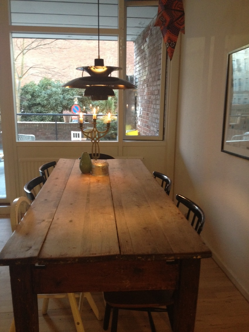 Dining table in the living room, fits up to 10 people. The flat has two children chairs.