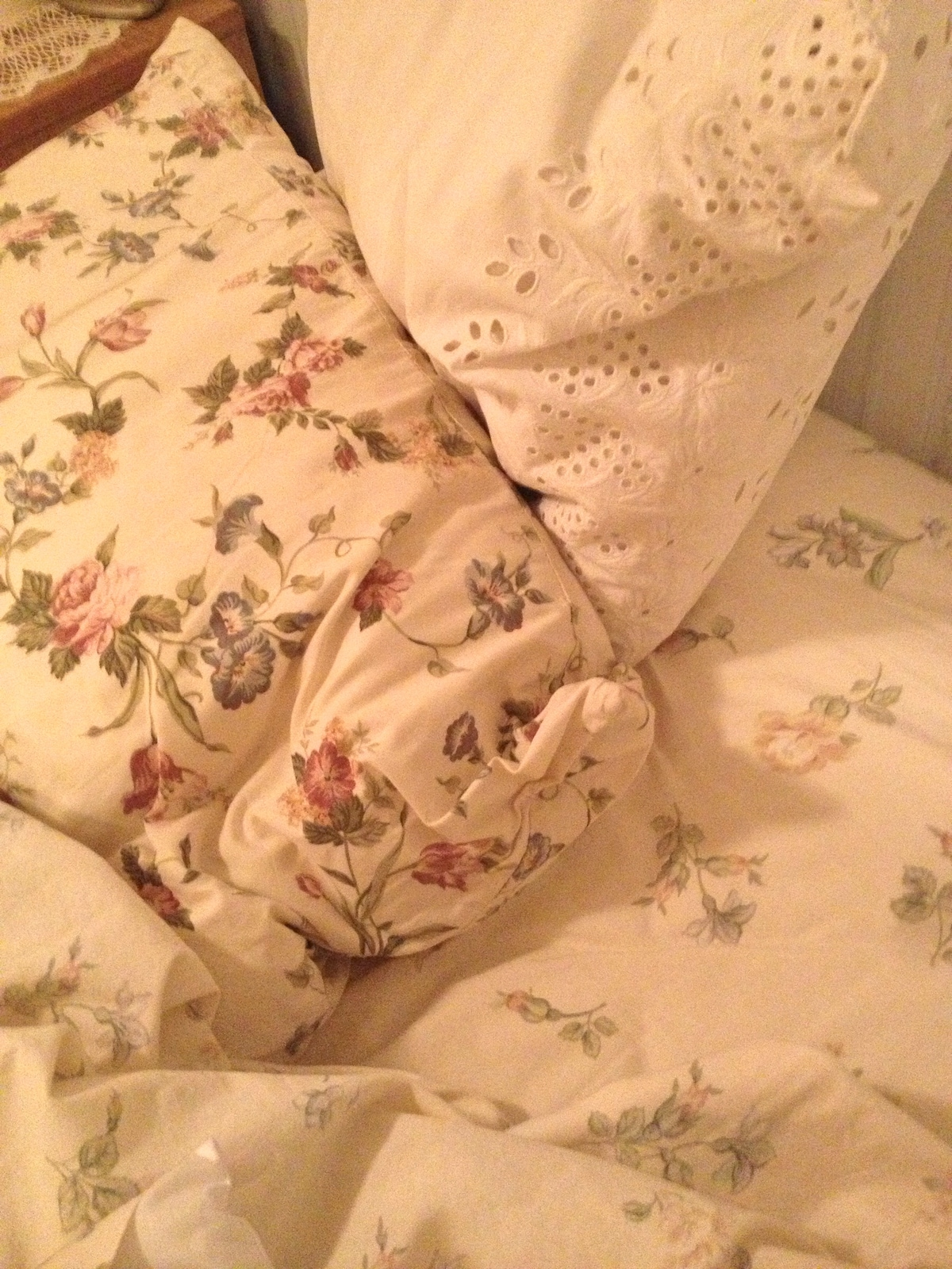 Changing the sheets. These were my mother's linens.
