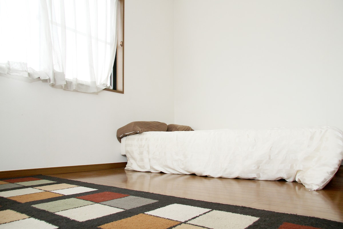 Rental room with one single bed and small foldout ikea couch