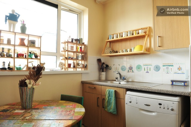 Kitchen with hand-painted cups and collaged table