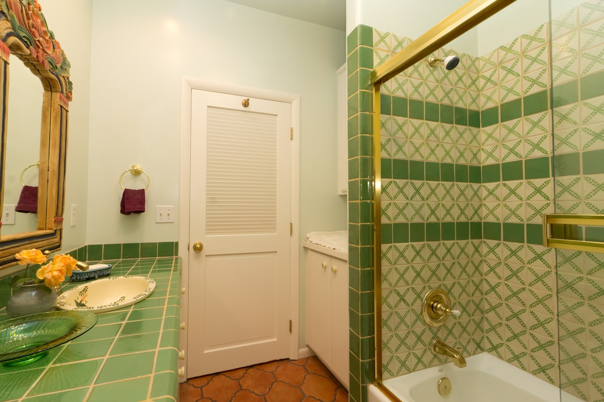 Tub in shower enclosure