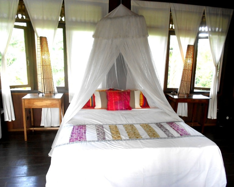 Master's Room upstairs. Own design bedcover with local silk. Windows on three sides: East (Sunrise over the Jungle), West side (Rice paddies), North on the Jungle.  High quality spring mattress resting on a teak wood platform, a most comfortable nest