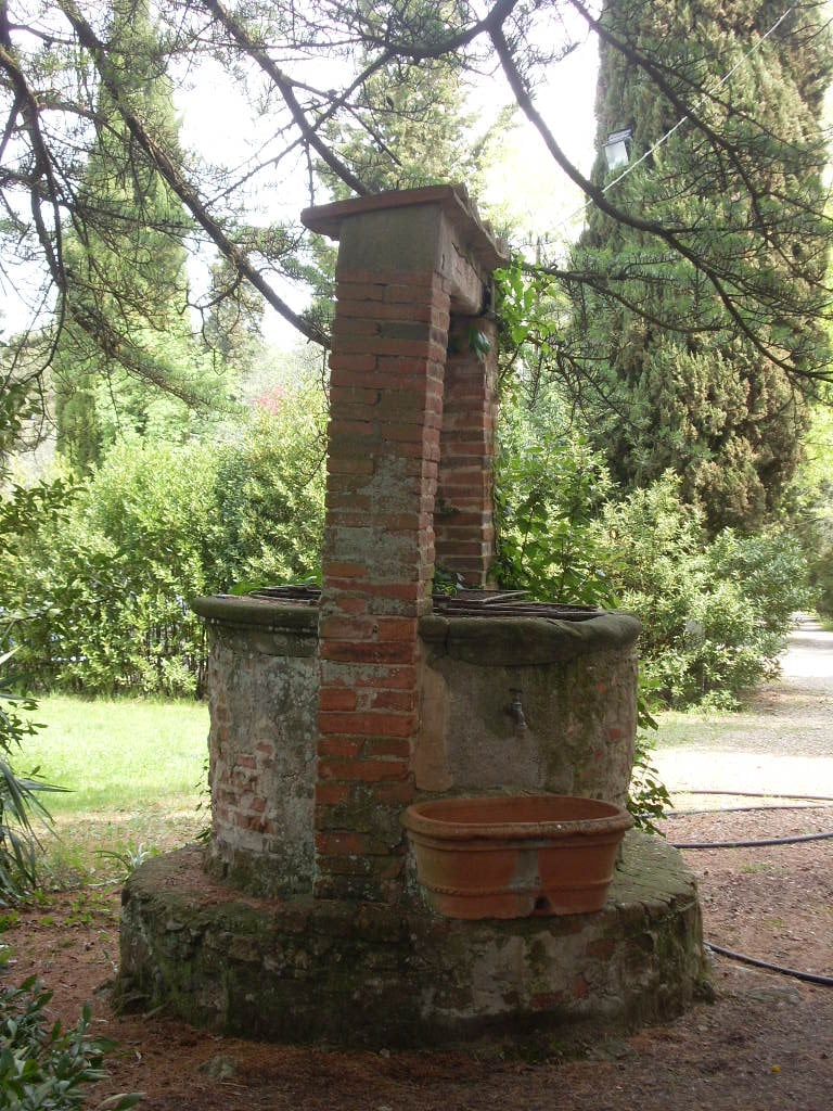 Old stone well in the garden