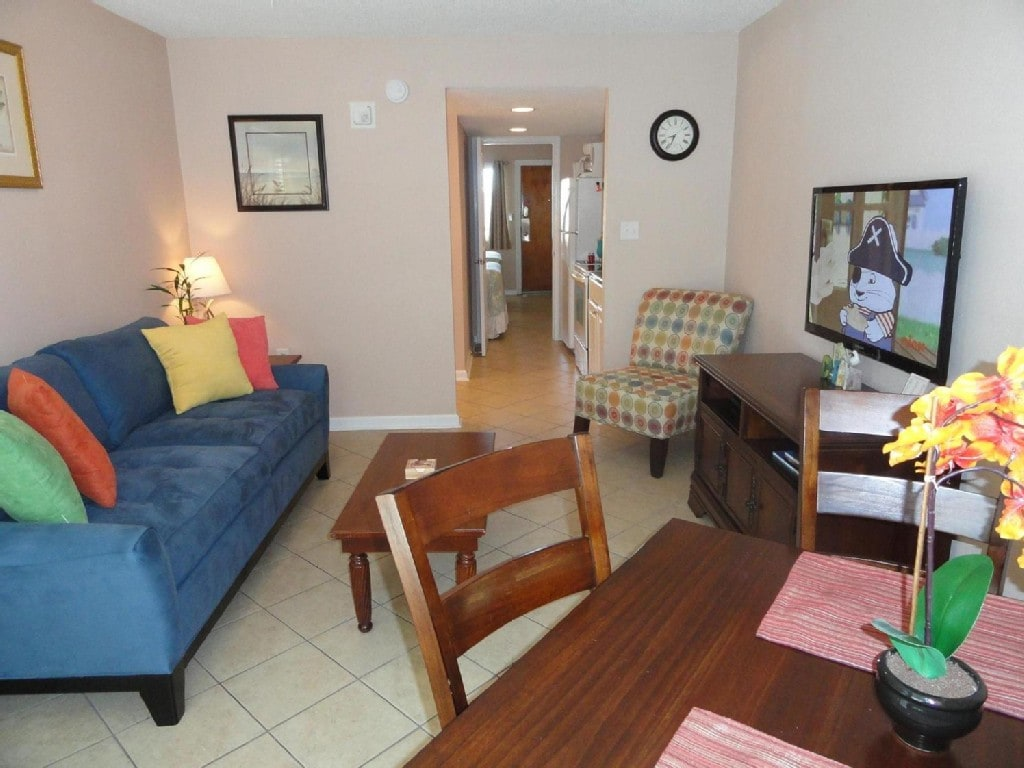 Queen Sleeper Sofa, Flat Screen TV/DVD, and Clean Tile throughout unit.
