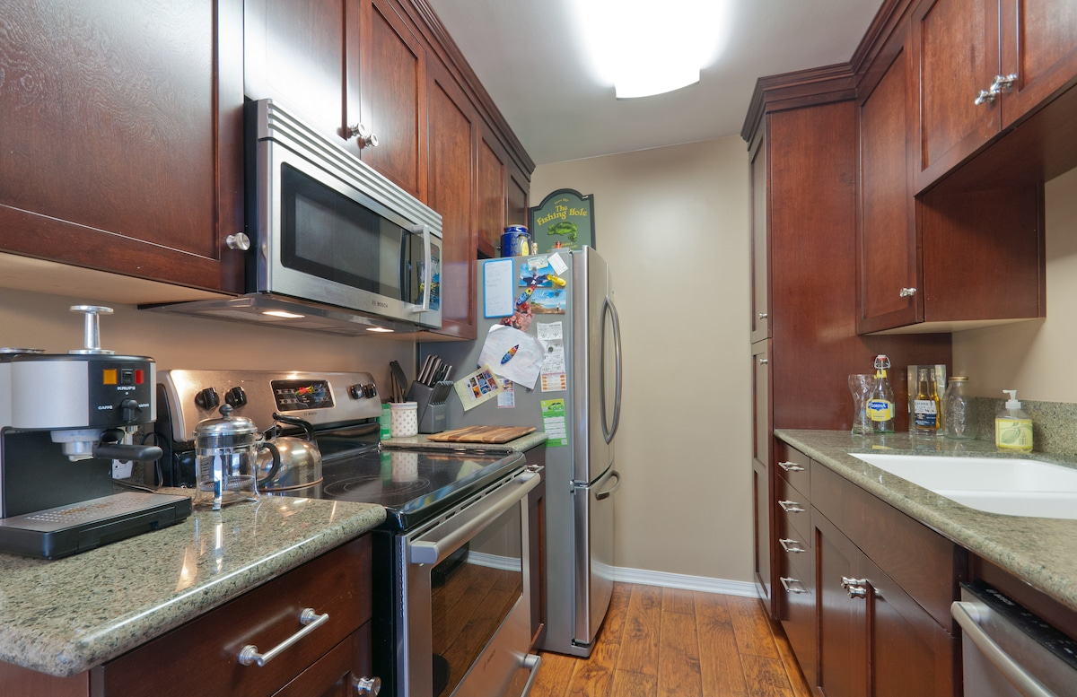 Remodeled kitchen with espresso machine and french press