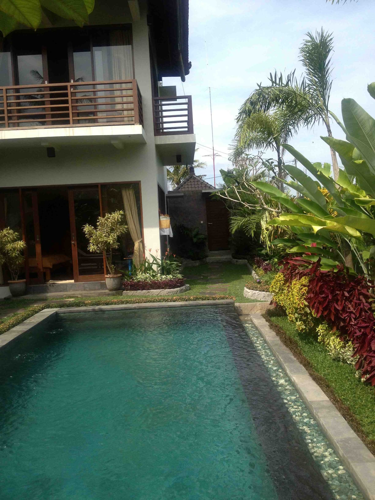 The beautiful infinity pool with your ground level bedroom visible at the end