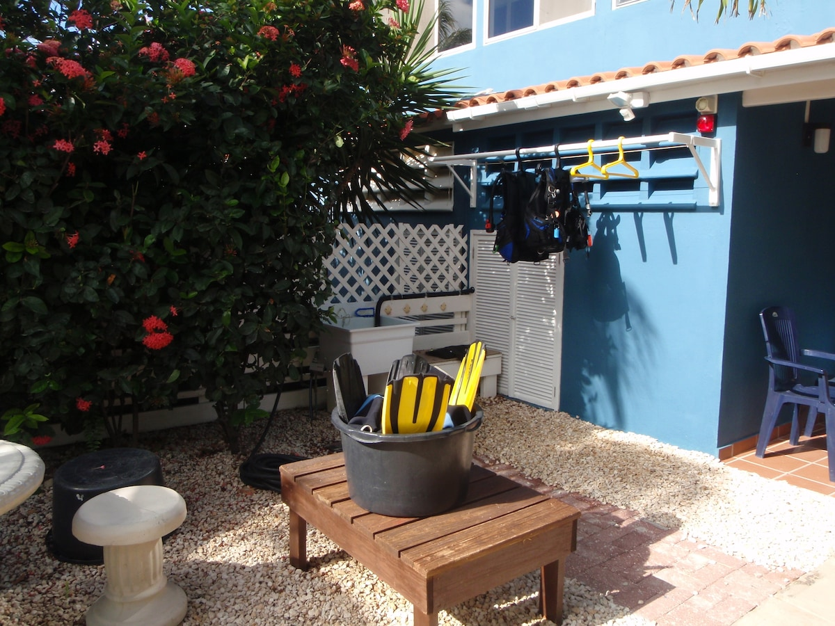 Fresh water gear rinse sink and outdoor drying area in the front yard.