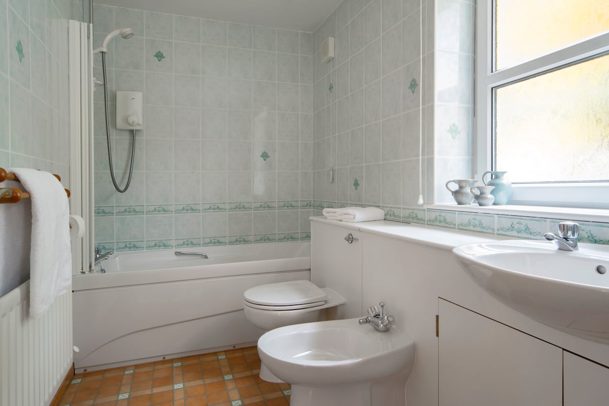 En suite bathroom with power shower.