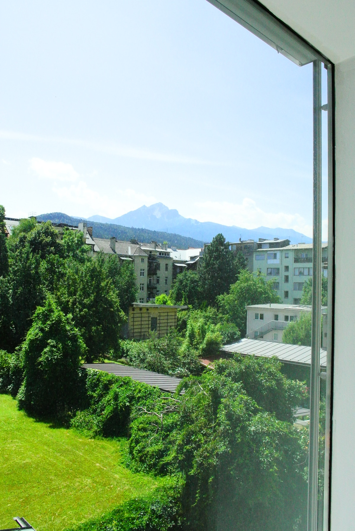 view from the dining area to the green courtyard and mountains