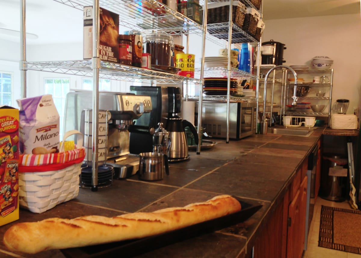 Stainless steel fixtures and appliances, espresso, coffee, microwave, dishwasher, and oven and stove