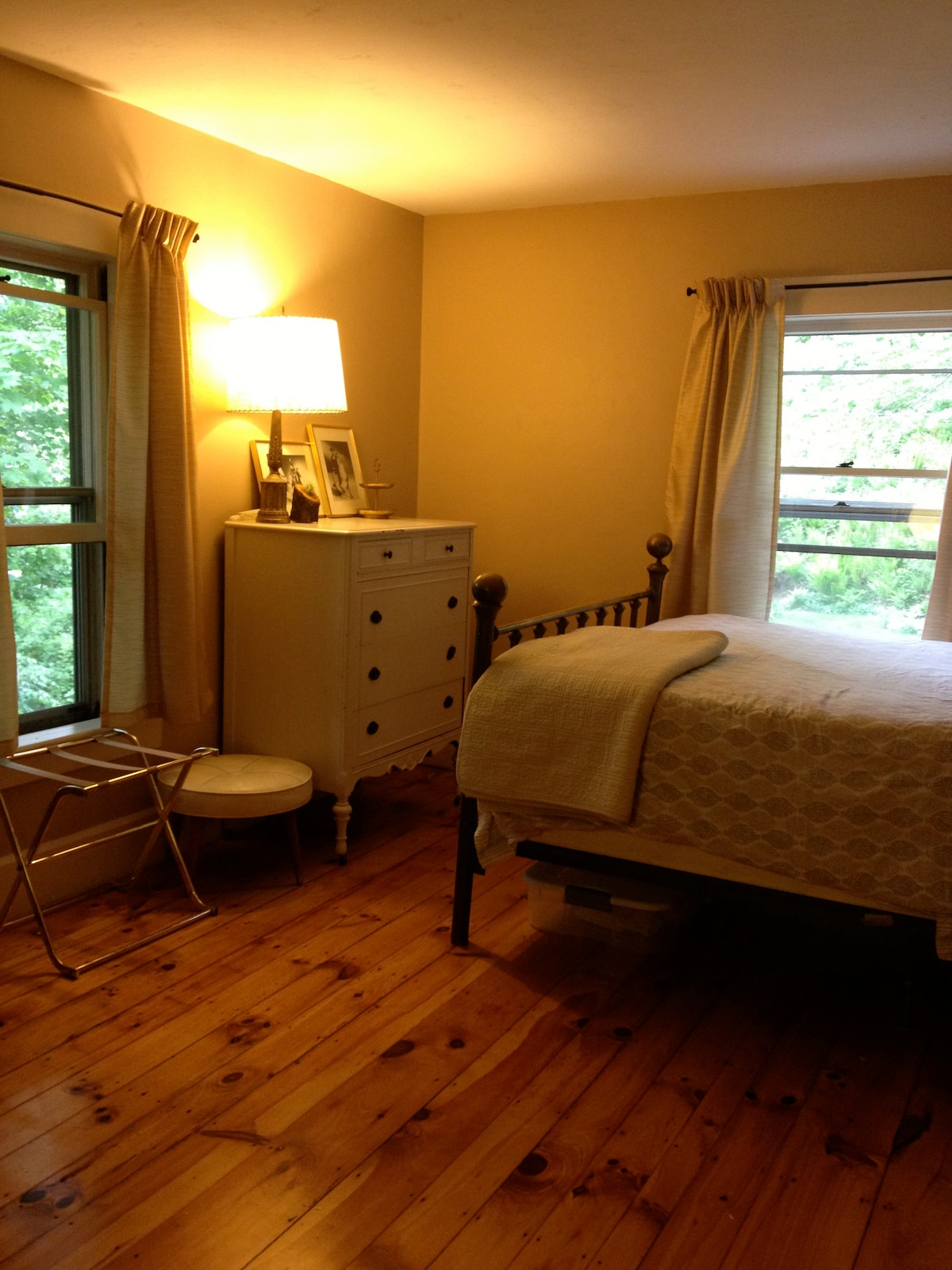 The master bedroom, with a queen size bed. It's nice and bright in the morning.