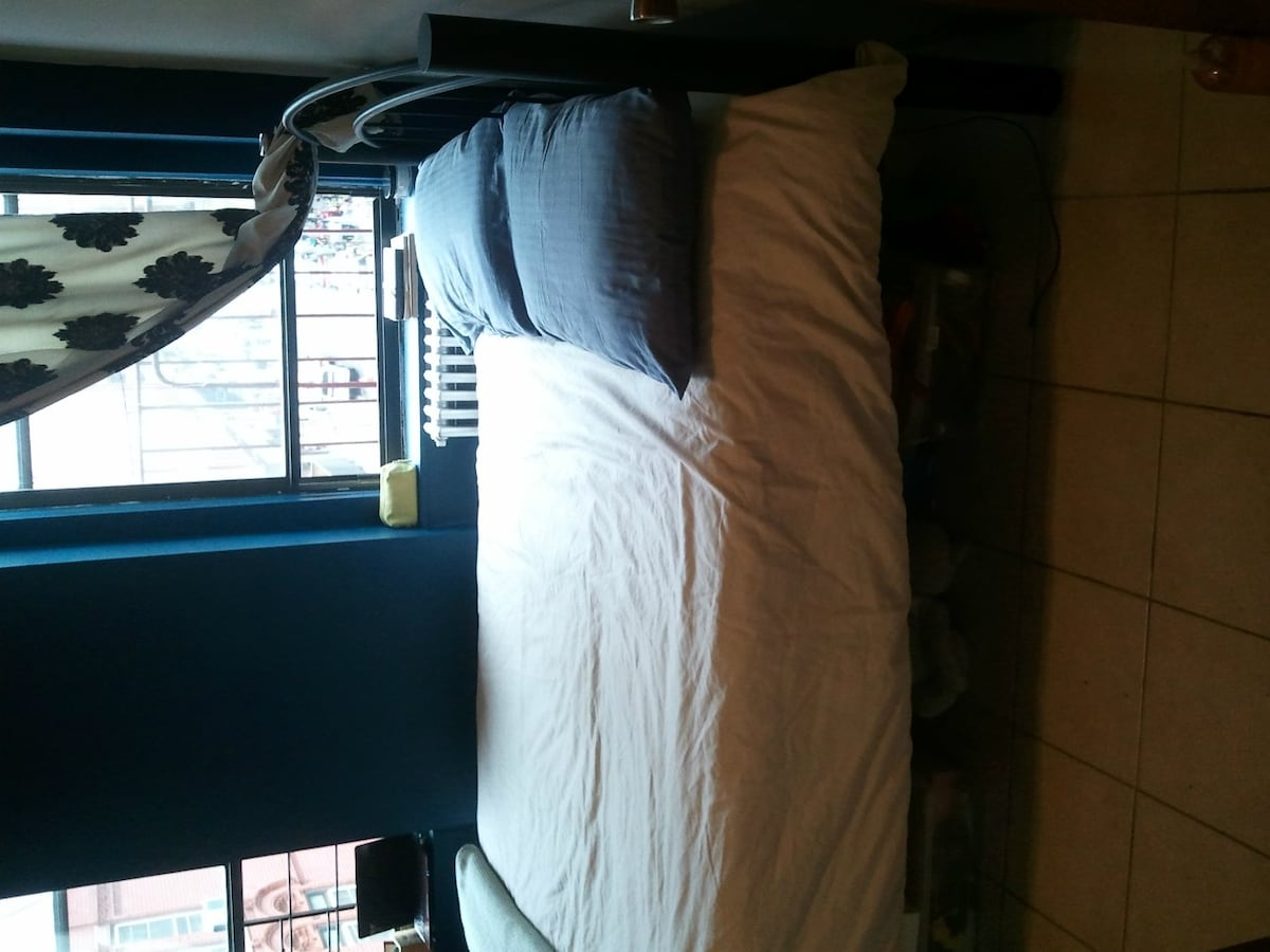 Full size bed with view to Elizabeth Street