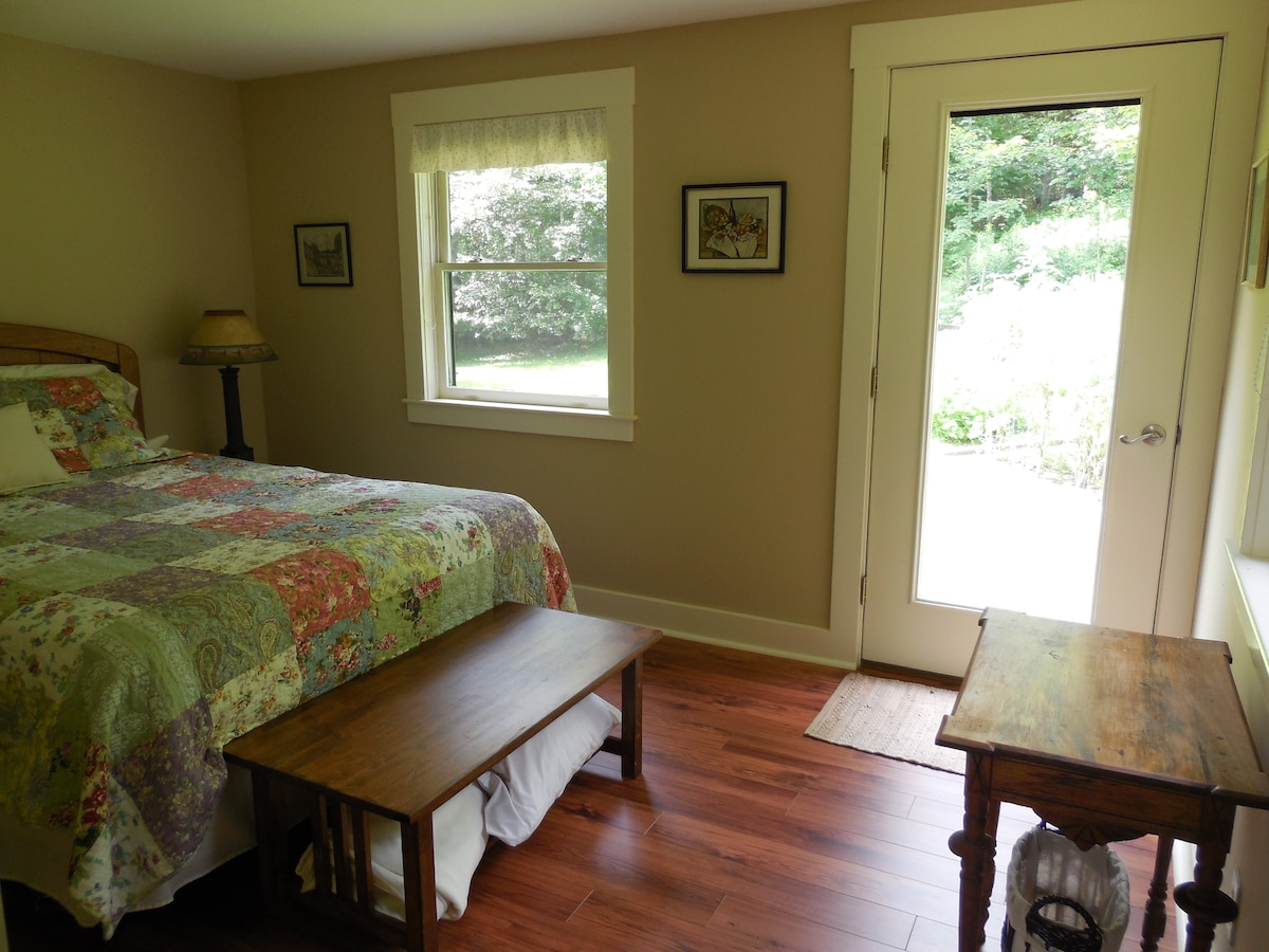 Secluded guest room looking out to backyard gardens