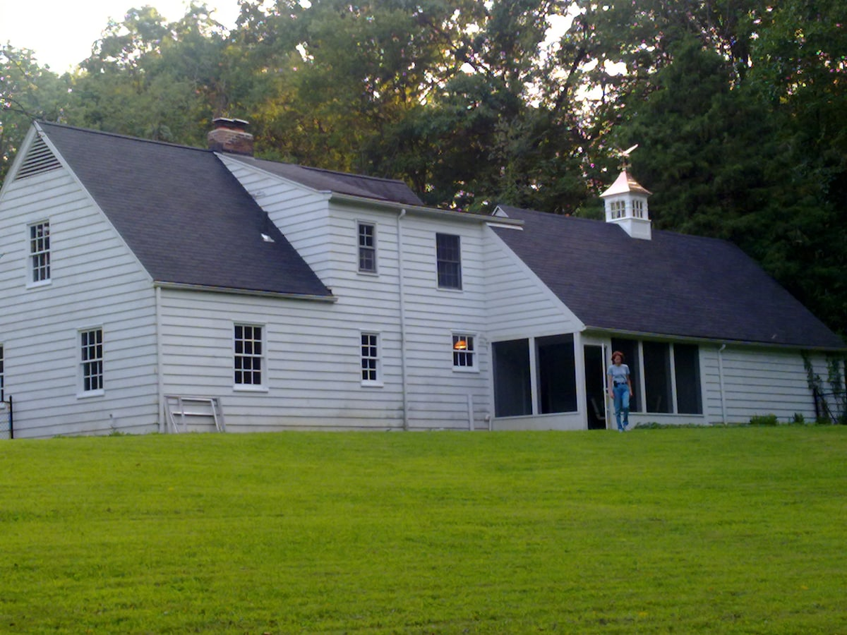 Back view from fenced-in area showing screened-in porch