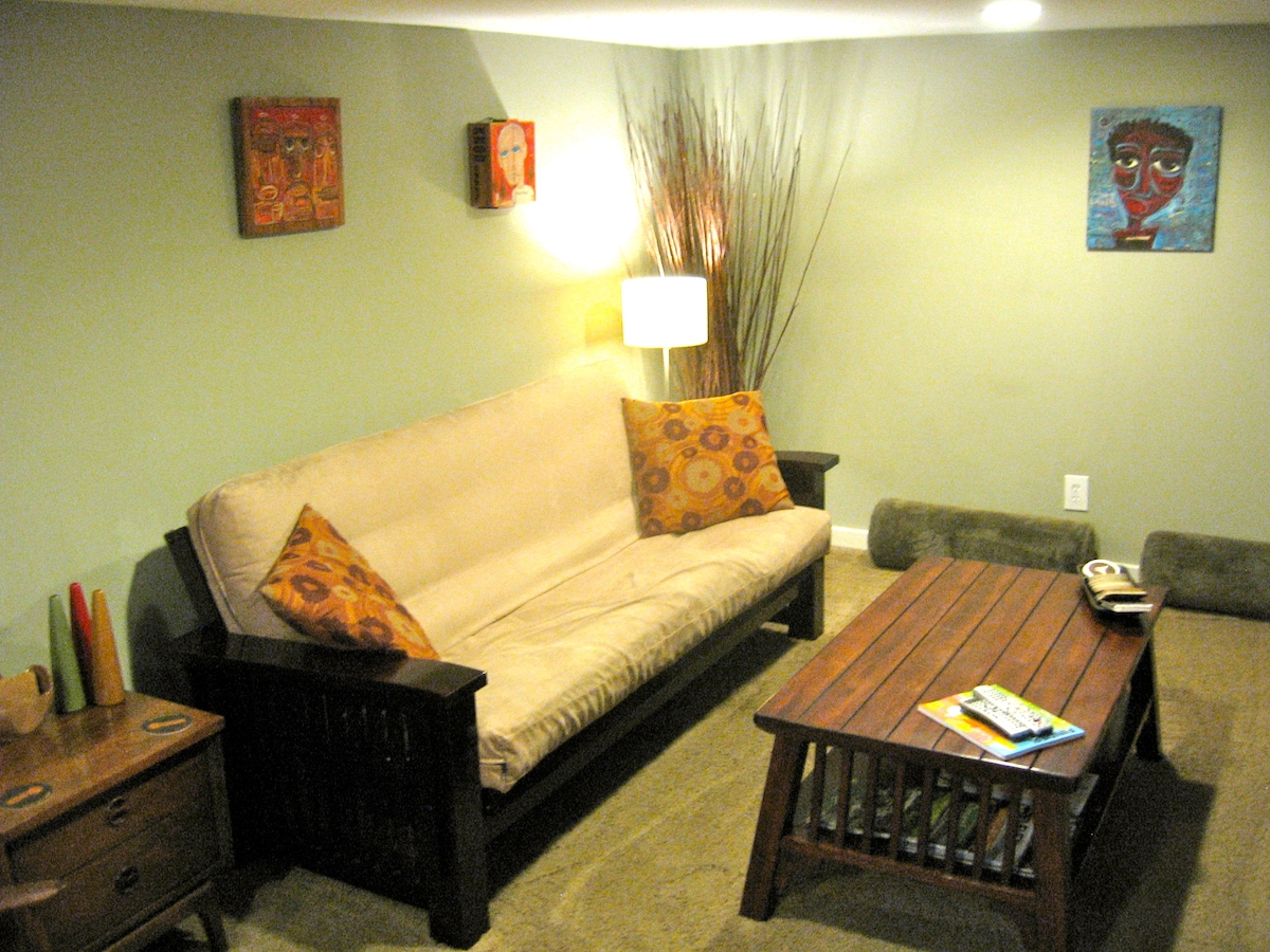 This is the cozy living room with local art & a full size futon.